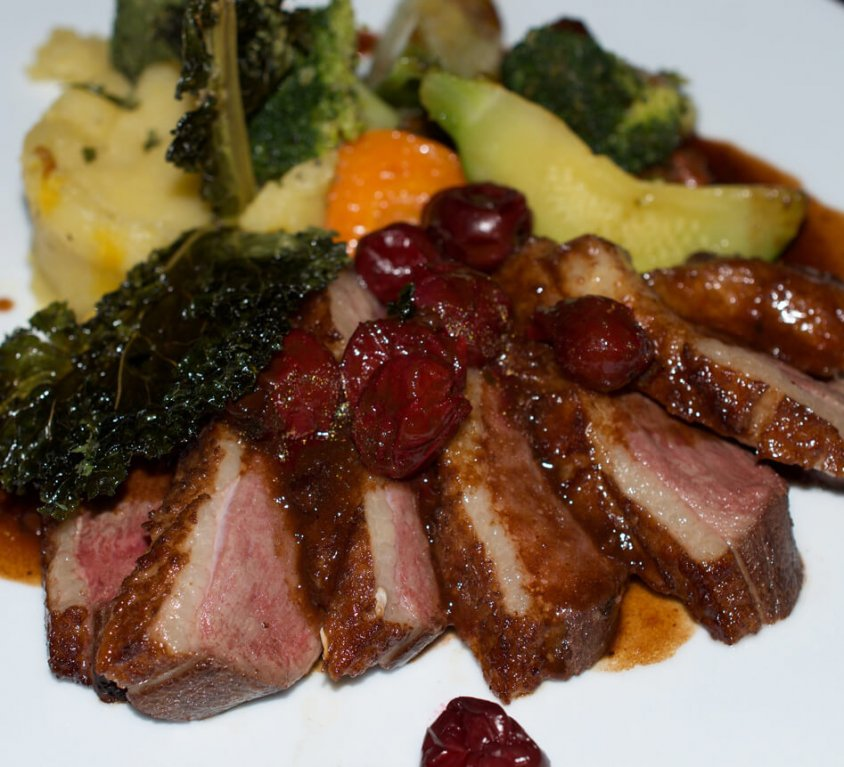 Roast duck breast with honey and Morello cherries