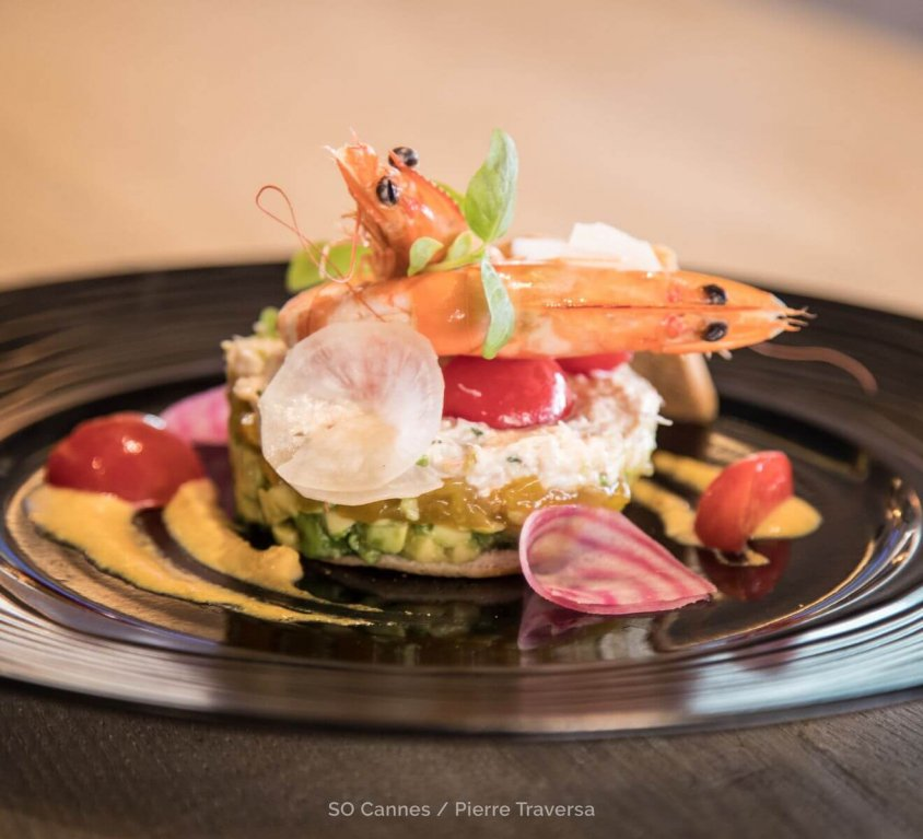 Crab and avocado millefeuille with yuzu and mango